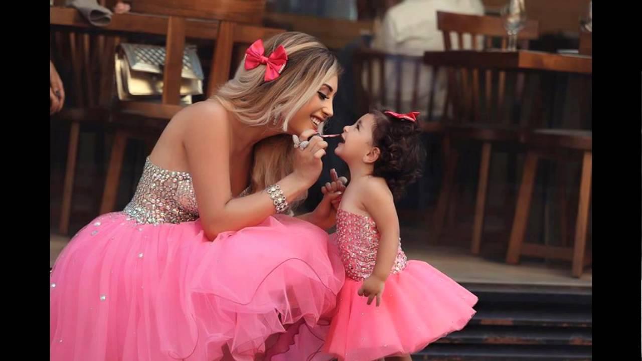 صور أحدث تصميمات لفساتين الطفله مع أمها منوعة